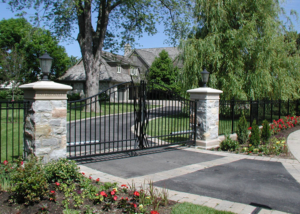 swing gate in masonry columns with custom scrollwork