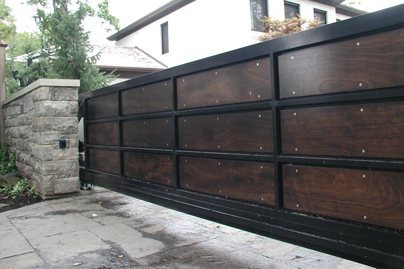 wood aluminum slide gate with masonry columns