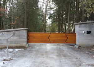 Modern wood slide gate in masonry columns