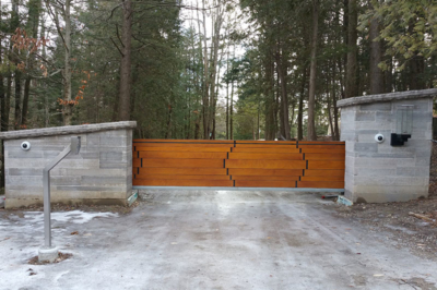 Modern wood slide gate in masonry columns