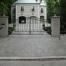 Rosedale swing gate with masonry columns