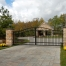 swing gate with masonry columns estate home