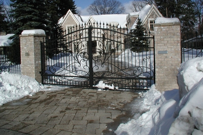 Swing Gate with scrollwork and masonry columns